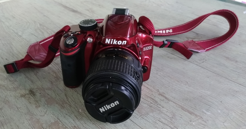 Nikon Digital SLR on a table with lens cap on