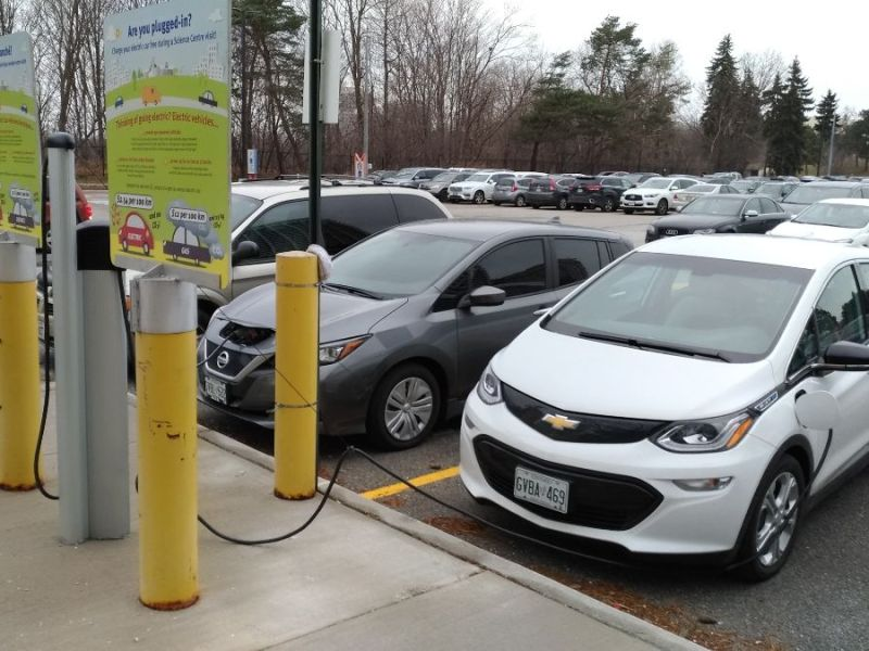 Chevrolet Bolt plugged in at a charging station