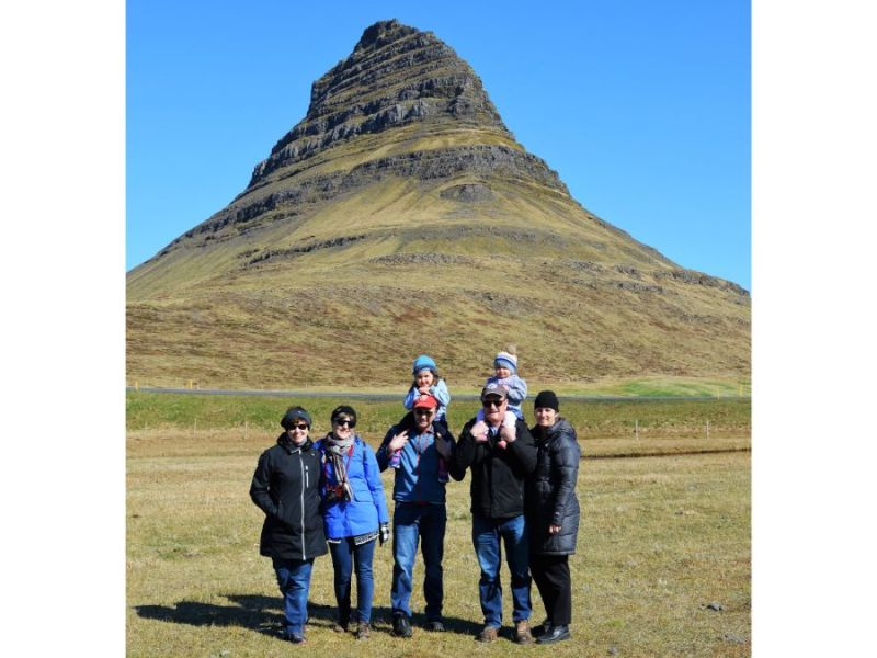 Extended Family standing in front of a mountain in Iceland