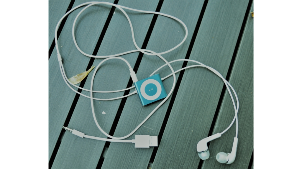 Ipod Shuffle headphones charger on tabletop