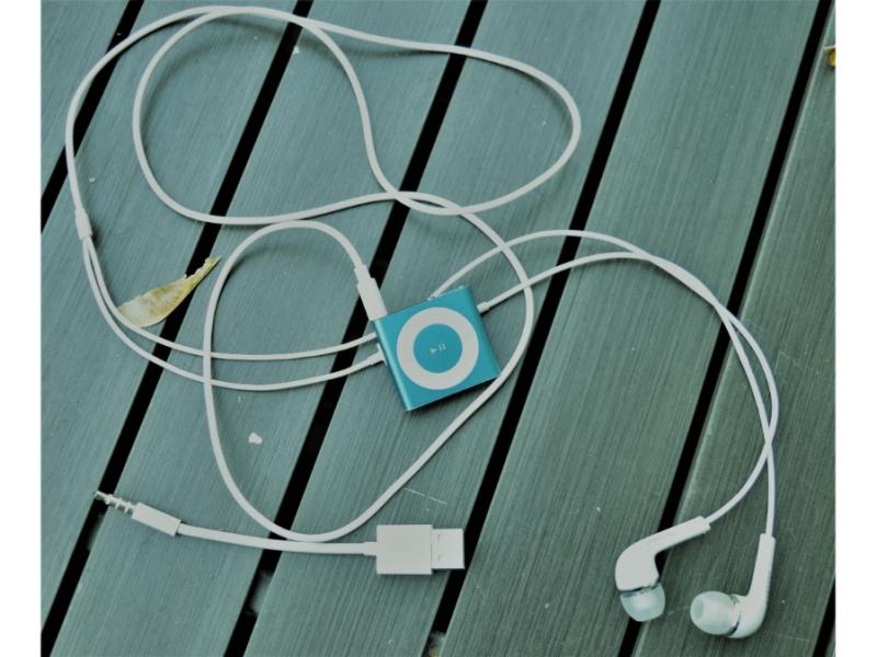 Ipod Shuffle headphones charger on tabletop